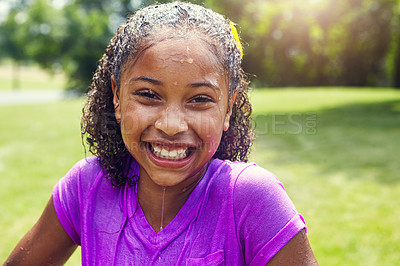 Buy stock photo Portrait of an adorable little girl wet of water balloons outdoors