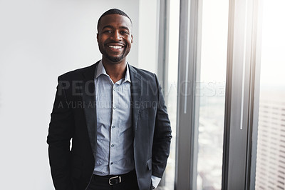 Buy stock photo Shot of a professional businessman standing in an office
