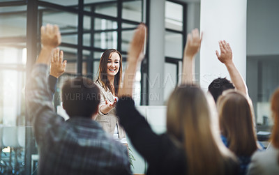 Buy stock photo Cropped shot of a young businesswoman fielding questions during a presentation in the boardroom
