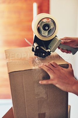 Buy stock photo Closeup shot of an unidentifiable woman using tape to pack boxes while moving house