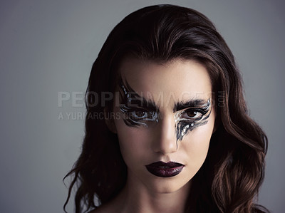 Buy stock photo Studio shot of an attractive young woman wearing bold makeup