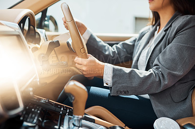 Buy stock photo Cropped shot of an unrecognizable businesswoman driving her car