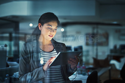 Buy stock photo Shot of a young businesswoman working late in the office