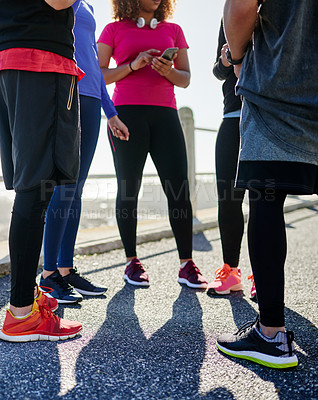 Buy stock photo Shot of a group of young unrecognizable friends hanging out together before a fitness exercise outside during the day