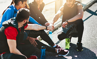 Buy stock photo Shot of a fitness group motivating each other before a run