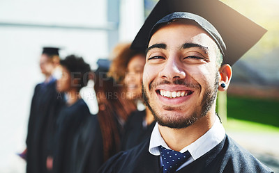 Buy stock photo Shot of a smiling university student on graduation day with classmates in the background