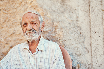 Buy stock photo Portrait of a senior man sitting outside on the sidewalk of an ancient city