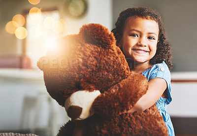 Buy stock photo Portrait of a little girl holding her teddy bear at home