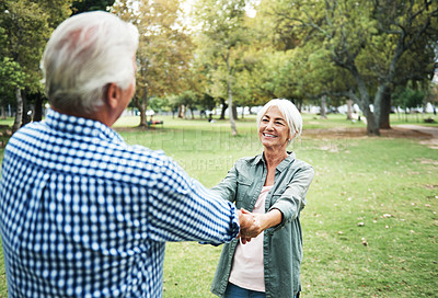 Buy stock photo Shot of a happy senior couple having fun in the park