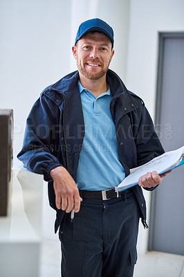 Buy stock photo Cropped portrait of a handsome delivery man waiting in the lobby with a customer's order