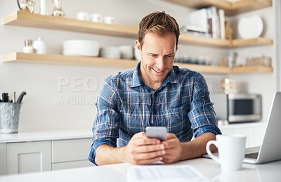 Buy stock photo Shot of a mature man using a cellphone and laptop at home