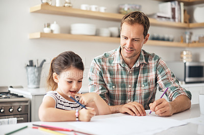 Buy stock photo Shot of a father and his little daughter coloring in together at home