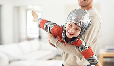 Buy stock photo Cropped shot of an adorable little boy dressed as an astronaut while playing make believe with his dad