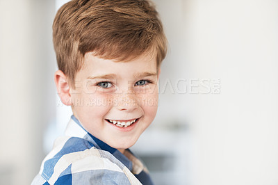 Buy stock photo Cropped portrait of an adorable little boy sitting in the kitchen at home