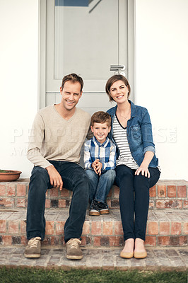 Buy stock photo Full length portrait of an affectionate young family of three sitting on their porch outside