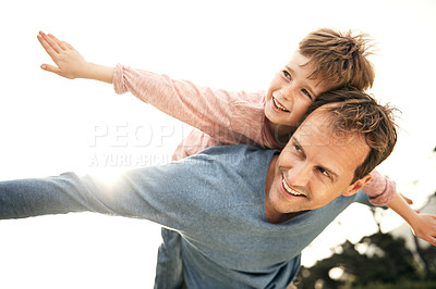 Buy stock photo Cropped shot of a father piggybacking his young son