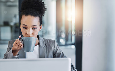 Buy stock photo Cropped shot of an attractive young businesswoman drinking a cup of coffee in her office