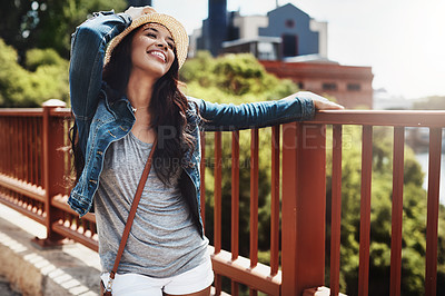 Buy stock photo Shot of a playful young woman spending the day outdoors