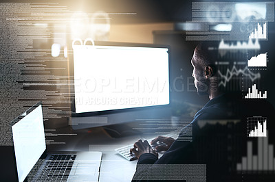 Buy stock photo Cropped shot of a young male hacker cracking a computer code in the dark