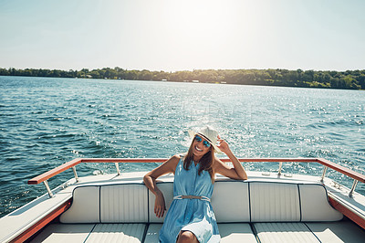 Buy stock photo Portrait of an attractive young woman spending the day on her private yacht