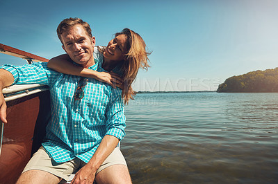 Buy stock photo Portrait of a young couple spending time together on a yacht