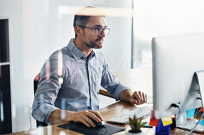 Buy stock photo Cropped shot of a businessman working on his computer at his desk
