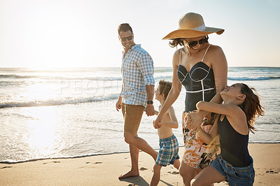 Buy stock photo Shot of a family of four spending the day at the beach