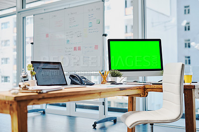 Buy stock photo Shot of an unoccupied desk with a computer and digital tablet on it inside of a office during the day