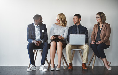 Buy stock photo Studio shot of businesspeople waiting in line against a white background