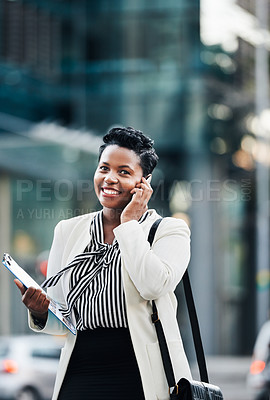 Buy stock photo Portrait of a young businesswoman using a mobile phone on the go in the city