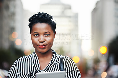 Buy stock photo Portrait of a young businesswoman holding a digital tablet in the city