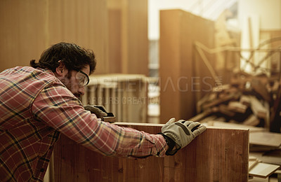 Buy stock photo Cropped shot of a craftsman sanding down one of his projects