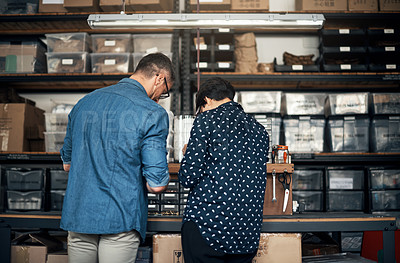 Buy stock photo Shot of a man and woman manufacturing something in a workshop