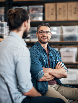 Buy stock photo Shot of a colleagues having a discussion in a workshop