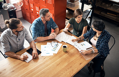 Buy stock photo Shot of a group of colleagues having a meeting in a workshop