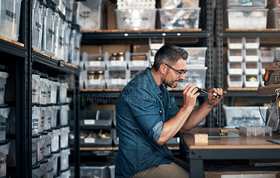 Buy stock photo Shot of a mature man busy in a workshop