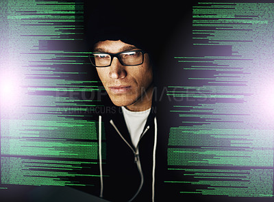 Buy stock photo Cropped shot of a young hacker cracking a computer code in the dark
