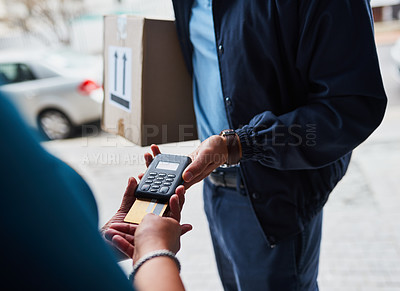 Buy stock photo Cropped shot of an unrecognizable man delivering a package to a customer and receiving payment with a card