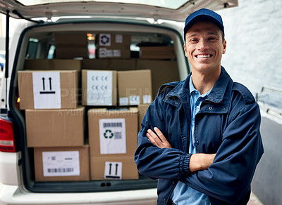 Buy stock photo Cropped shot of a handsome young man standing by his delivery van