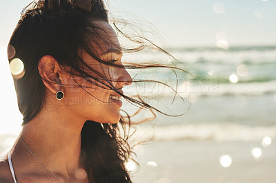 Buy stock photo Shot of a beautiful young woman enjoying a summer's day at the beach