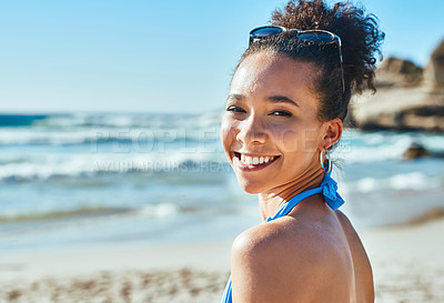 Buy stock photo Portrait of a beautiful young woman enjoying a summer's day at the beach