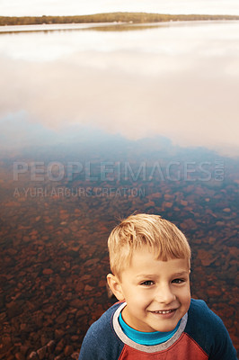 Buy stock photo Cropped shot of a little boy standing outside