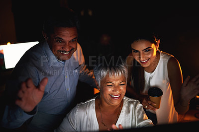 Buy stock photo Shot of a group of colleagues waving while making a video call on a computer at night in an office