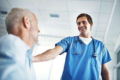 Buy stock photo Low angle shot of a male nurse caring for a senior patient
