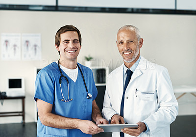 Buy stock photo Portrait of two medical practitioners using a digital tablet in a hospital