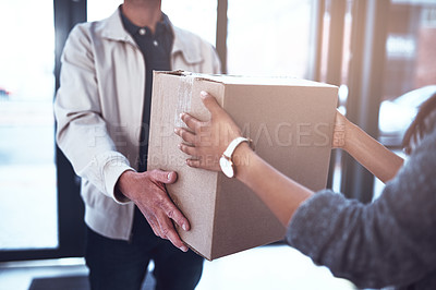 Buy stock photo Shot of a unrecognizable man handing over a package to a customer inside of a office building during the day