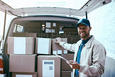 Buy stock photo Portrait of a cheerful young delivery man standing next to a van full of boxes while holding a digital tablet