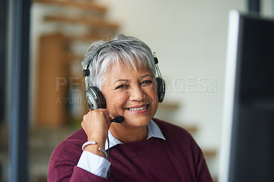 Buy stock photo Portrait of a mature woman working on a computer in a call centre