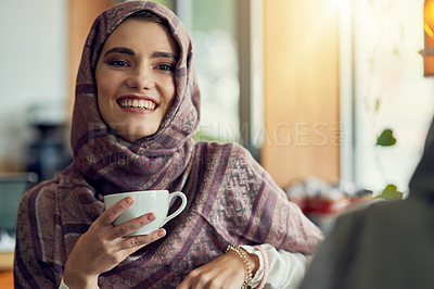 Buy stock photo Shot of a young woman having a coffee with her friend in a cafe