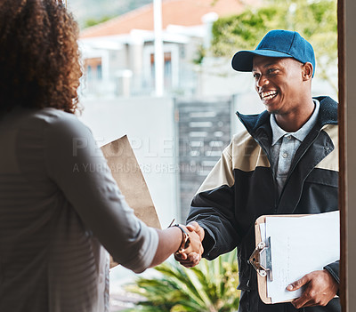 Buy stock photo Shot of a courier shaking hands with a customer while making a delivery